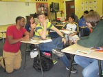High school students at Pine Tree High School making plans for their mock business during UT Tyler recruiting trip.