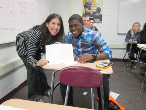 Academic Advisor Stephanie Long poses with Troup high school student who drew her a picture during recruiting trip.