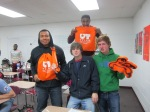 High school students at Troup High School posing with UT Tyler prizes during recruiting trip.