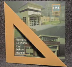 Brochure design for EMA, a triangle gate-fold front view