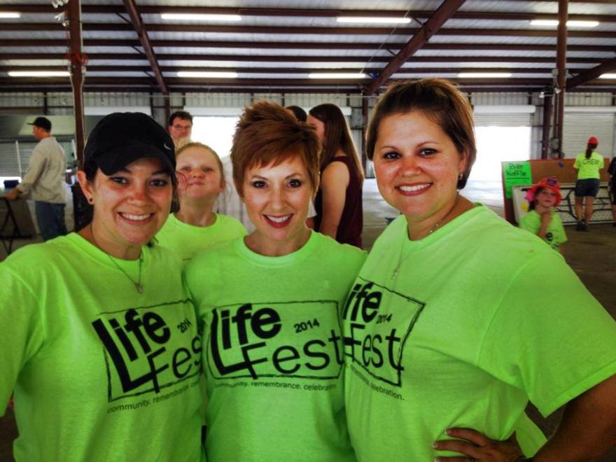 Three Life Fest 2014 volunteers posing for photo in green t-shirts with Life Fest logo design