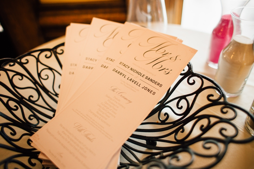 Design for wedding programs, script and sans serif bold, gray lettering on pale pink background, fanned out in wireframe basket