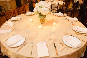 Menus tucked into napkins at table setting, wedding reception menu design.