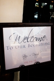 "Large ""Welcome to our beginning"" welcome sign in frame."